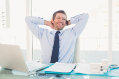 Relaxing businessman at his desk Royalty Free Stock Image