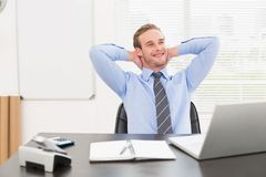 Relaxing businessman at his desk Stock Photos
