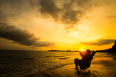 Relaxing Businessman Sitting On Beach Royalty Free Stock Photo