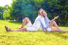 Relaxing caucasian Couple Sitting Outdoors Together. Listening T Royalty Free Stock Photography