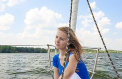 Relaxing Caucasian Woman Travelling on Yacht and Smiling. Stock Image