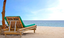 Relaxing Chair on white sandy Beach Royalty Free Stock Photo
