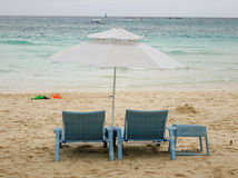 Relaxing chairs on the beach in Boracay, Philippines Stock Images