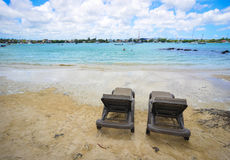 Seascape in Grand Baie, Mauritius. Relaxing chairs on the beach in Grand Baie, Mauritius. Mauritius, an Indian Ocean island nation, is known for its beaches Royalty Free Stock Photography