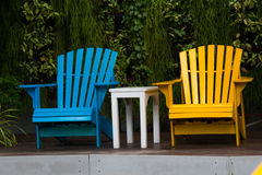 Relaxing chairs in garden royalty free stock photography