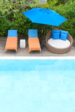 Relaxing chairs beside of swimming pool Stock Photo