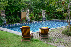 Relaxing chairs with swimming pool in Bali, Indonesia Stock Photo