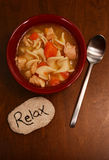 Relaxing and chicken noodle soup Stock Images