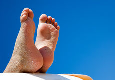 Relaxing child feet on the beach Royalty Free Stock Photography