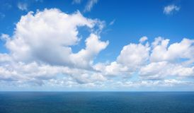 Relaxing cloudscape with blue sky. Over the sea stock image