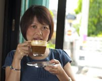 Relaxing in a coffee cafe Royalty Free Stock Photography