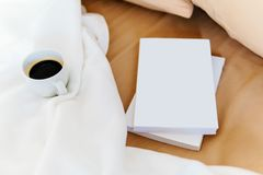 Relaxing With Coffee Cup And Good Books In Bed Royalty Free Stock Images