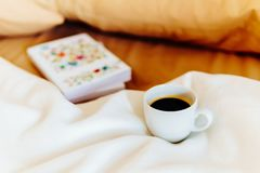 Relaxing With Coffee Cup And Good Books In Bed Stock Photography