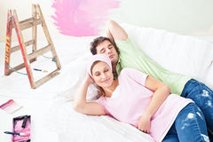 Relaxing couple lying on the sofa after painting Stock Image