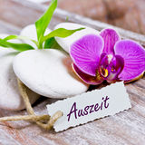 Relaxing coupon. With stones and orchids Stock Photos