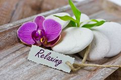 Relaxing coupon. With stones and orchids Stock Photography