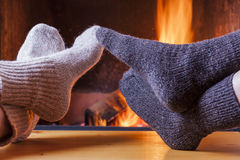 Relaxing at the cozy fireplace on winter evening Stock Image