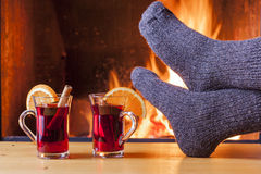 Relaxing at the cozy fireplace on winter evening Royalty Free Stock Photo