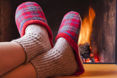 Relaxing at the cozy fireplace on winter evening Stock Photo
