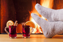 Relaxing at the cozy fireplace on winter evening Royalty Free Stock Photography