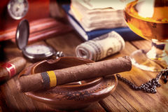 Relaxing cuban cigar after hard day Royalty Free Stock Image