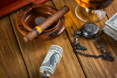 Relaxing cuban cigar after hard day Royalty Free Stock Photography