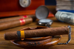 Relaxing cuban cigar after hard day Stock Photo