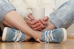 Relaxing with a cup of drink Royalty Free Stock Images