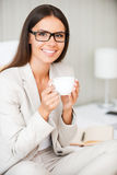 Relaxing with cup of fresh coffee. Royalty Free Stock Photo