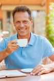 Relaxing with cup of fresh coffee. Royalty Free Stock Photography