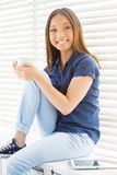 Relaxing with cup of fresh coffee. Royalty Free Stock Image