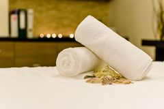 Relaxing day at spa. Two towels sitting on a massage bed. Relaxing treatment, for a healthy body, soul, mind stock photos
