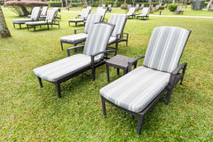 Relaxing deck chairs at tropical resort with nobody. Relaxing deck chairs at tropical resort with lush grass with nobody Stock Photos