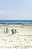 Relaxing in a deckchair on a tropical beach Stock Image