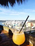 Relaxing with a drink. Cocktail drink with a view of an ocean marina Royalty Free Stock Images