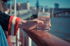 Relaxing with drink of water on a boat Stock Photos