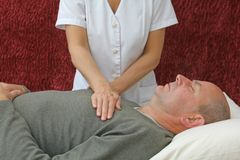 The Relaxing Effects of Reiki Healing Stock Photography