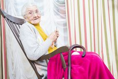 Relaxing elderly hobby Royalty Free Stock Image