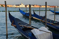 Relaxing evening in gondolas harbor, Venice Royalty Free Stock Photo