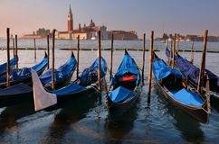 Relaxing evening in gondolas harbor, Venice Stock Photos