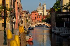 Relaxing evening on a Venetian canal Stock Photo
