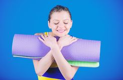 Relaxing exercise. Happy woman workout with fitness mat. Health diet. Success. Sporty woman training in gym. Sport mat stock photos