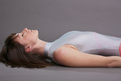 Relaxing exercises on ground Stock Photo