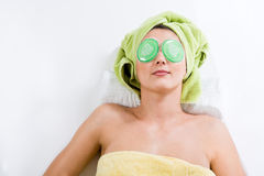 Relaxing with Eye Pads Royalty Free Stock Photo