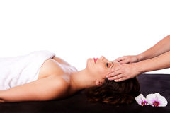 Relaxing Facial massage in spa Stock Image