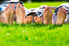 Relaxing. Family relaxing on the grass Royalty Free Stock Image