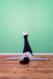 Relaxing with feet on green wall Royalty Free Stock Photography