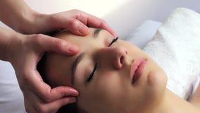 Relaxing female facial massage.