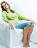 Relaxing female model in white chair. Stock Photography