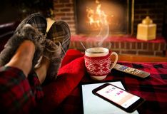 Relaxing by fireplace Royalty Free Stock Images